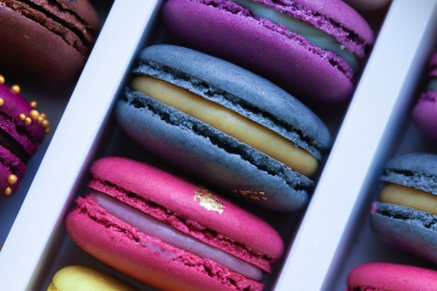 Assortment of multicolored macaroon different lie in the cardboard box