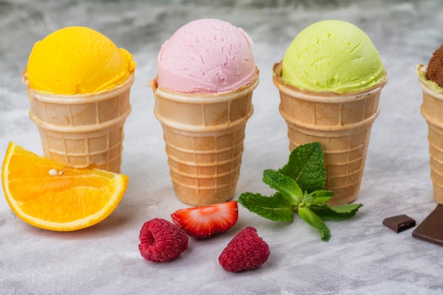 Assortment of natural ice cream - strawberry, chocolate, orange, blueberry and mint