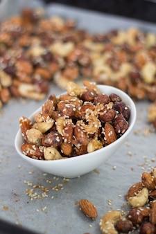 Assortment of nuts. cashew, hazelnuts, walnuts, seeds. food mix background.