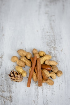 Assortment of nuts on a wooden background.