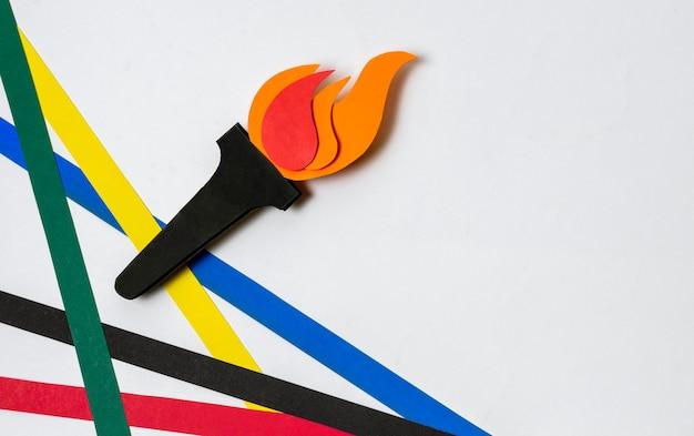 Ассортимент олимпийских фигур в бумажном стиле