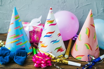 Assortment of party hats and balloons