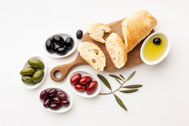 Assortment of olives bread slices and olive oil