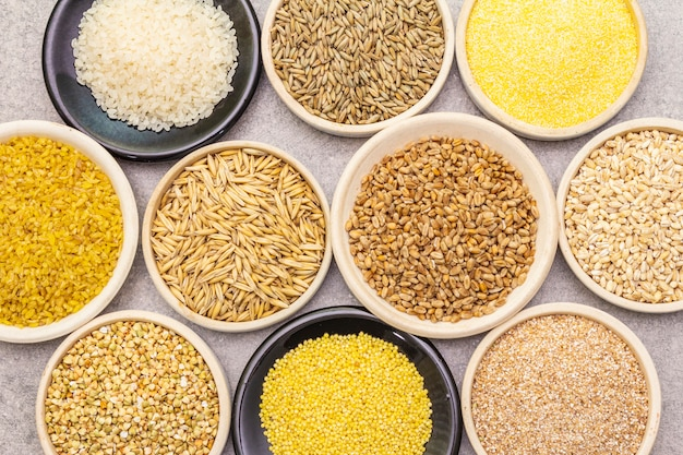 Assortment of organic cereals, legumes and whole grains in bowls
