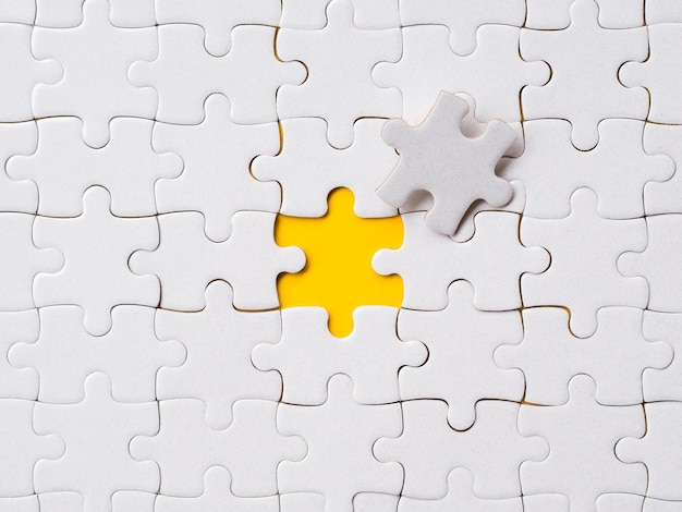 Assortment of puzzle pieces for individuality concept