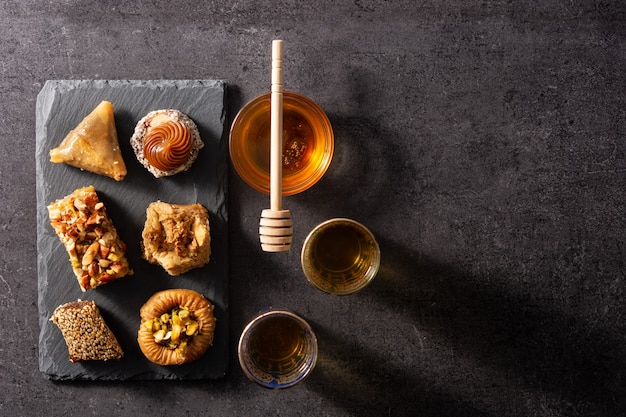 Assortment of ramadan dessert baklava on black background
