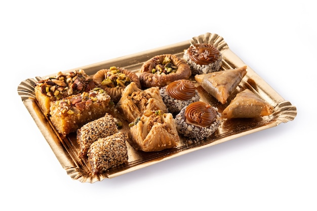 Assortment of ramadan dessert baklava isolated on white. traditional arabic sweets.