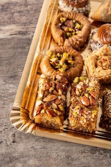 Assortment of ramadan dessert baklava  on wooden table