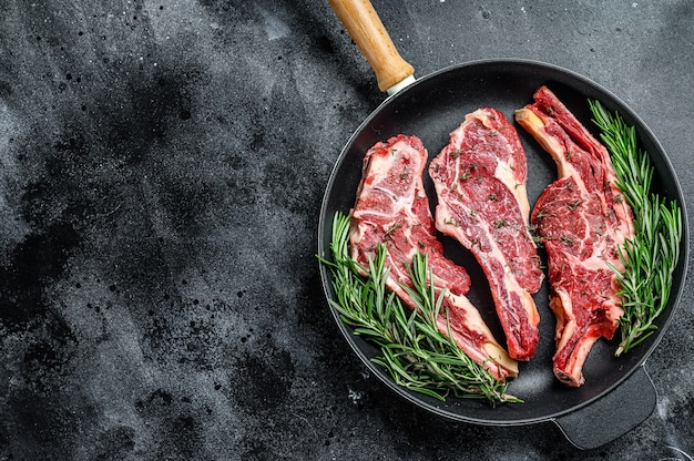 Assortment of raw cuts beef meat steaks in a pan
