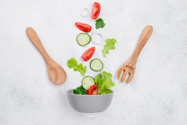 Assortment of salad ingredients on white background
