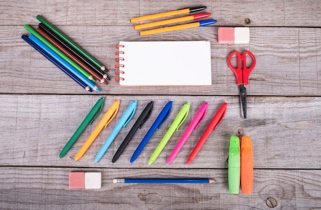 Assortment of school supplies of different colors for the school