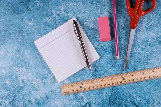 Assortment of school supplies. ruler, scissors, notepad