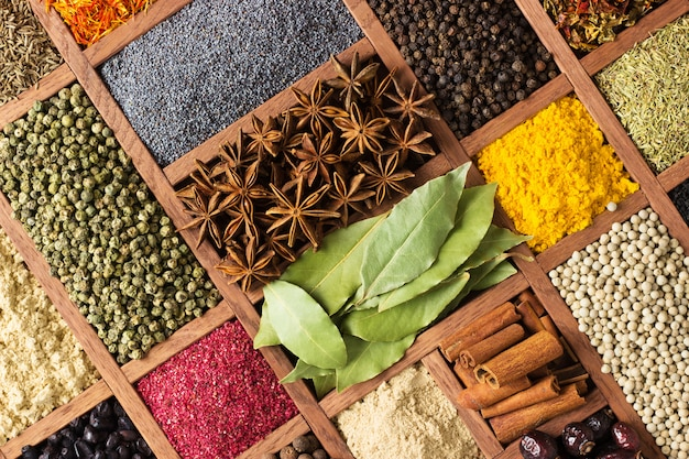 Assortment of spices and herbs in bowls