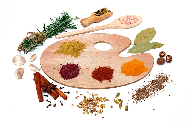 Assortment of spices on a polish for artist paints on a white background, top view, horizontal, no peope. high quality photo