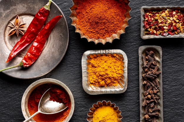 Assortment of spices with clove and chili peppers