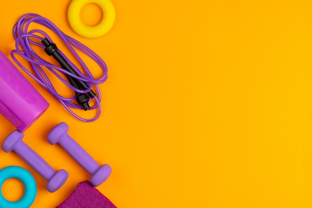 Assortment of sport equipment on yellow