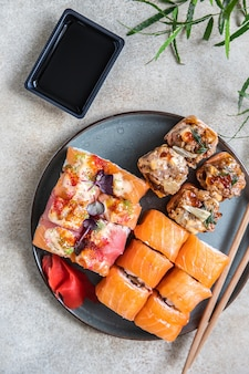 Assortment of sushi rolls served with ginger sushi menu japanese food