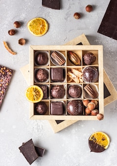 Assortment of sweet confectionery with chocolate candies and pralines in a gift box.