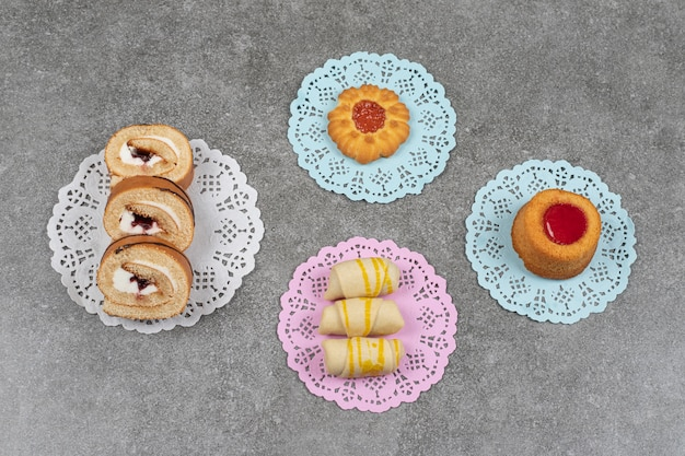 Assortment of sweet desserts on marble surface