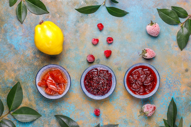 Assortment of sweet jams and seasonal fruits and berries,top view