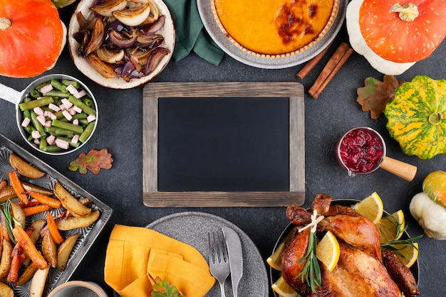 Assortment of thanksgiving day delicious dinner with blackboard