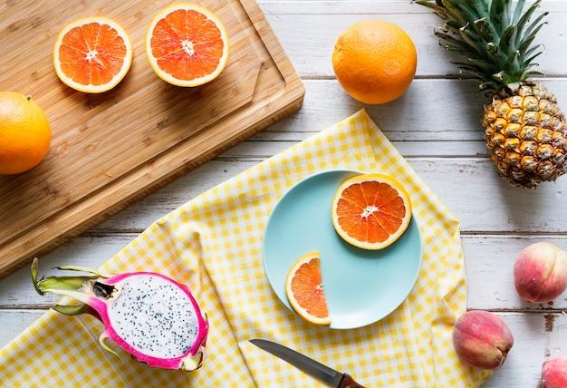 Assortment of tropical citrus fruits background