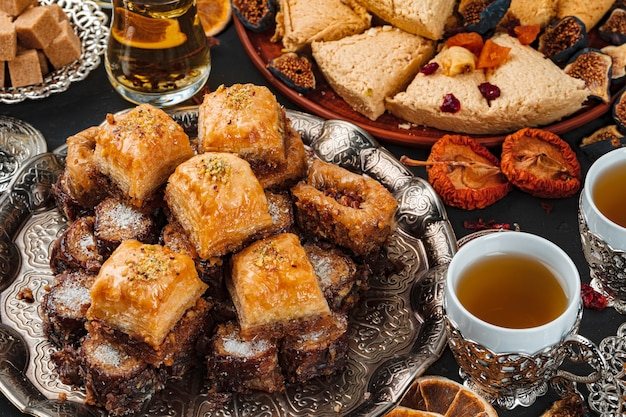 Assortment of turkish desserts and tea cups