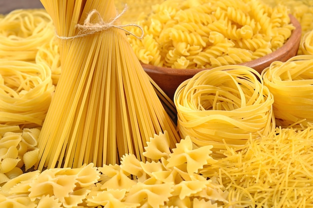 Assortment of uncooked italian pasta close up