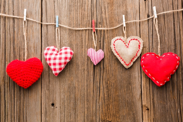 Assortment of valentines day ornaments on wooden background