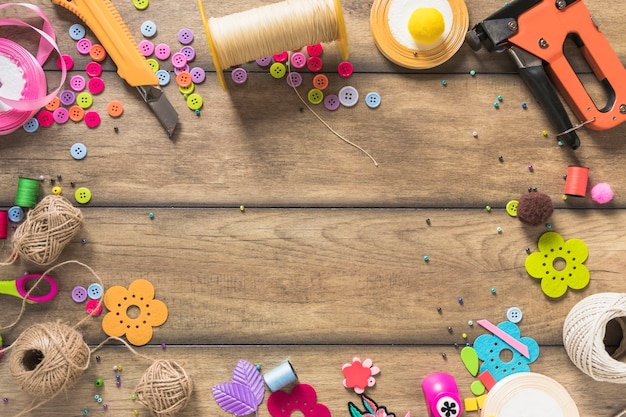 Assortment of various craft items on wooden background