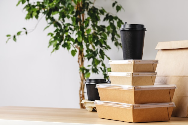 Assortment of various food delivery containers on table close up