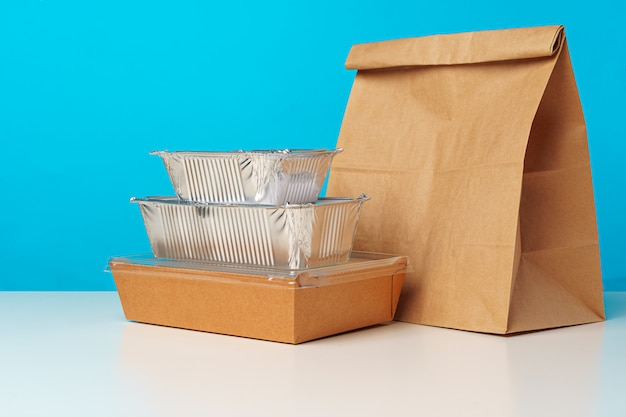 Assortment of various food delivery containers on table