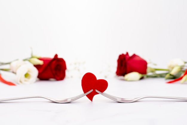 Assortment with beautiful roses and heart shape