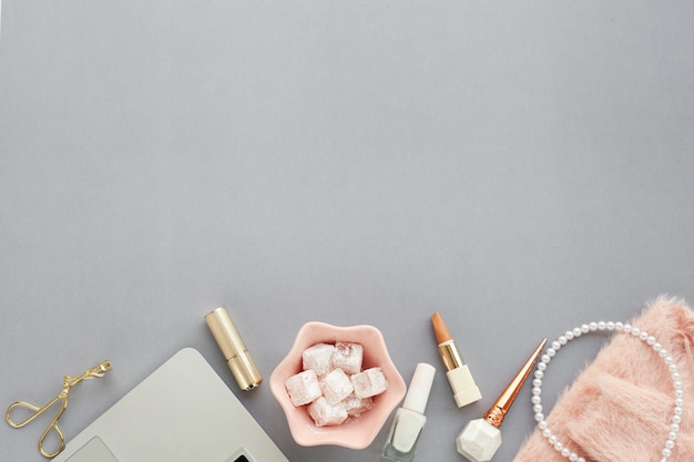 Assortment with beauty products on grey background and copy-space