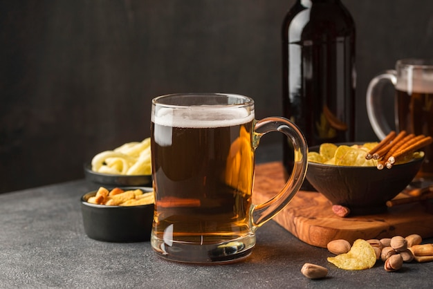 Assortment with beer mug and snacks