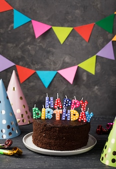 Assortment with birthday cake and party decorations