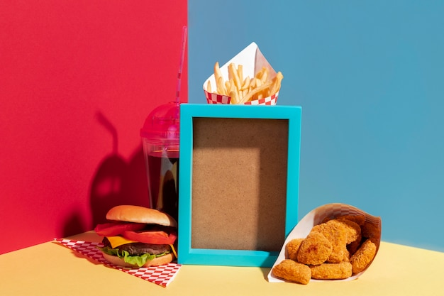 Assortment with blue frame and delicious food