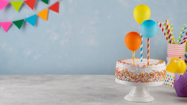 Assortment with cake and balloons