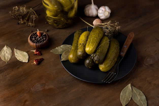 Assortment with delicious pickles on plate