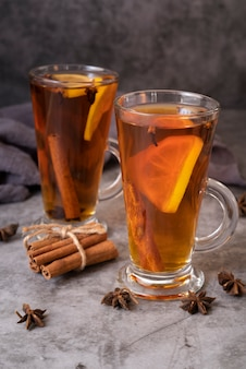 Assortment with glasses of tea and cinnamon sticks