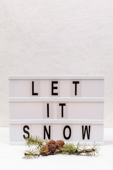 Assortment with let it snow sign
