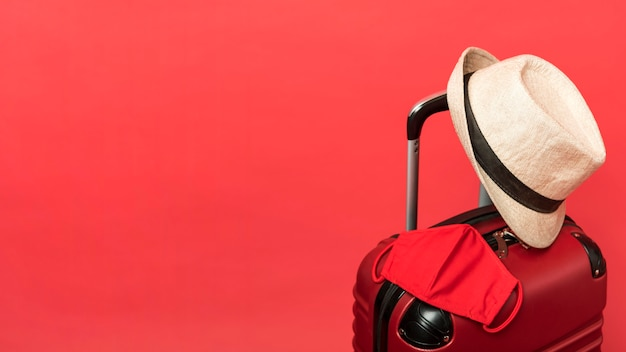 Assortment with luggage and red background