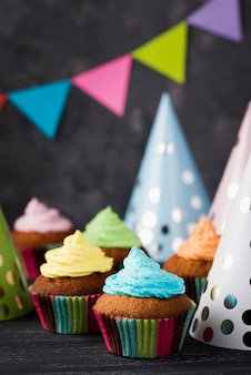 Assortment with muffins with colorful glaze