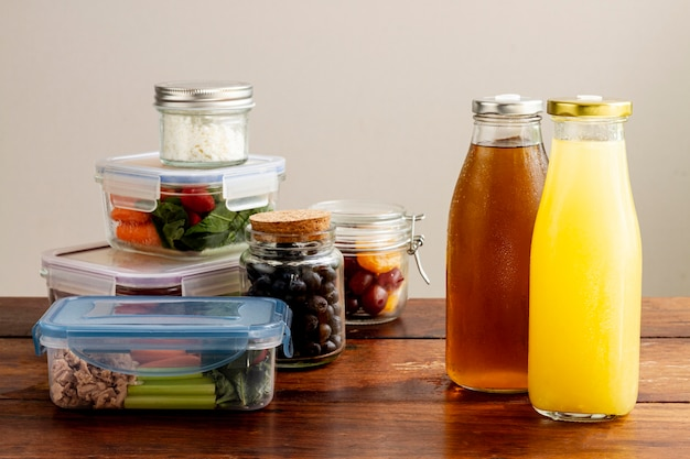 Assortment with packed food and juice bottles