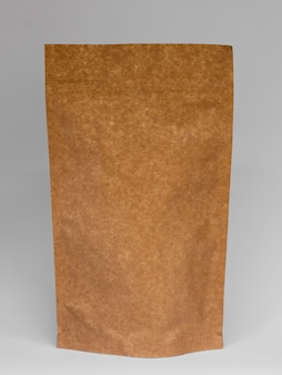 Assortment with paper bag and grey background