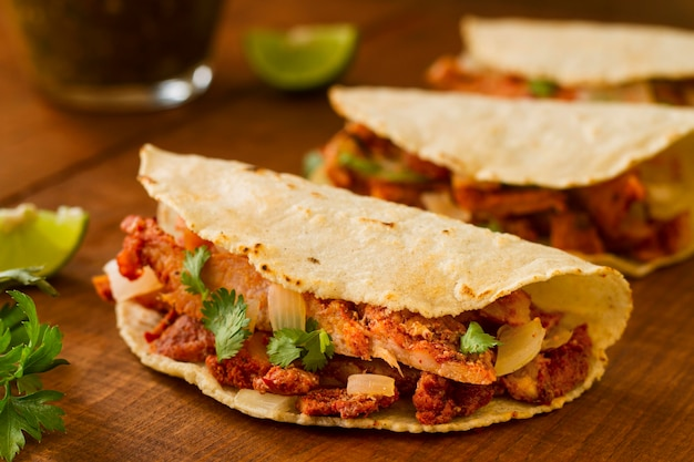 Assortment with tacos on wooden background