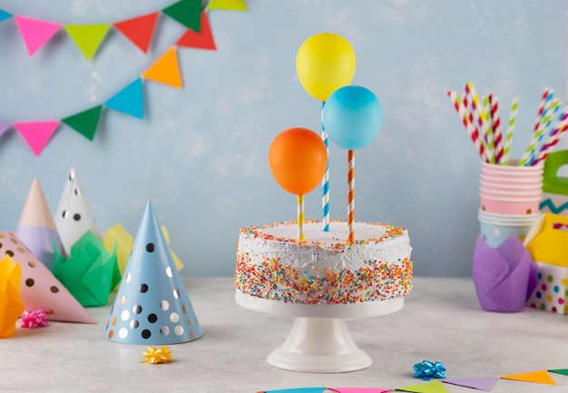 Assortment with tasty cake and balloons