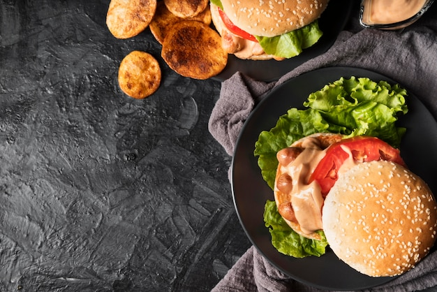 Assortment with tasty hamburger and copy space
