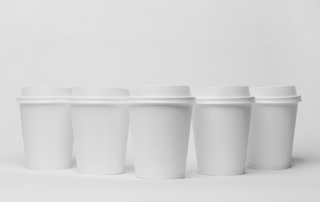 Assortment with white coffee cups
