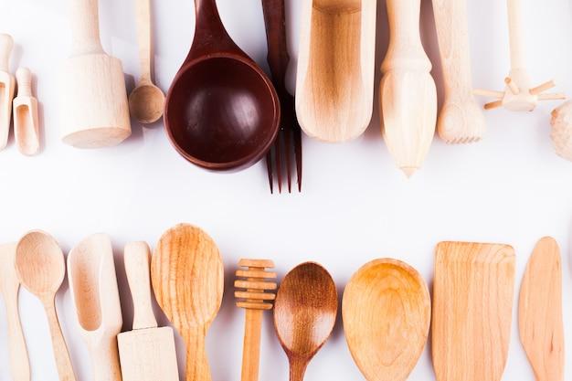 Assortment of wooden kitchen utensils on a white background